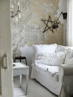 paint random paint colors lay cheesecloth over surface in certain areas only, apply sheet rock mud, dry, peel off cheesecloth to chip off mud leaving little bits behind or mix gray paint then white paint with plaster, trowel on wall and dry, apply hemp oil for resist, apply yellow milk paint, dry and scrape peeling paint