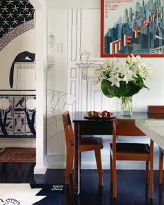 In this view, two wall coverings, Memphis and Fireplace – designed by Helen and available through Tektura – are juxtaposed; Helen bought the poster, designed by Boris Bilinsky, in Berlin; Metropolis is one of her favourite films for its set design. Bohemian House, Fireplace Design, Auckland, Oversized Mirror, Home And Garden, Set Design, Wallpaper, Memphis, Dining Rooms