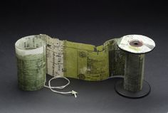 Yuko Kimura    Moss Spool Book no. 3  , 2012 Etching on antique book pages from Japan, linen thread, wooden spool 4.25 x 3 x 43 inches 10.8 x 7.6 x 109.2 cm YuK 20
