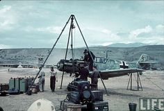 Luftwaffe ground crew working on an Me-109 at an airfield in Kresna Pass, Bulgaria in 1941.