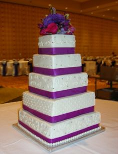 "Feeding nearly 300 guests? This might be the size you need. Each tier is decorated differently with purple bands around each. The venue was the Hilton Austin. Bigger cakes can be done at even lower costs than moderately sized cakes. The world standard for a 'piece of wedding cake' is 2"" x 2"" x 2"" or a 2"" cube of sheet cake. That's pretty small so you might want to consider ordering extra for your catering staff, photographer, musicians, etc. austinweddingcakelady@gmail.com"