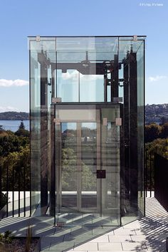 Exterior glass lift or elevator is a nice way to get down to the pool area.