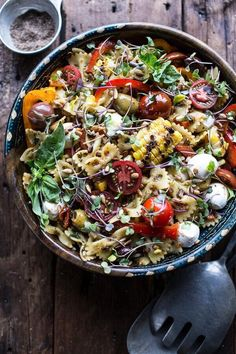 Looking for a yummy way to use up those leftover veggies, sauces and cheese? Try this Everything But the Kitchen Sink Pasta Salad from halfbakedharvest.com