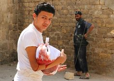 22 Of The Most Important Pictures This Week. Syrian baby. Who says we shouldn't take refugees?  This is horrific