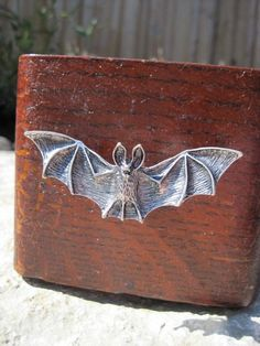 Bat drawer knobs / furniture knobs in Silver (MK120)  Bats, the underrated guardians of the night, symbolize death and rebirth. These are the only mammals
