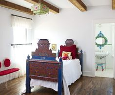 Amazing colors with clean white. Hand painted folk art bed Ashley Astleford eclectic bedroom Dallas