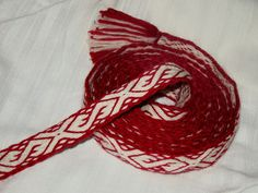 Tablet woven band inspired by Slavic motifs.