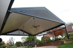View a range of great patio ideas & pergola designs with our gallery of flat, gable, pitched and fly-over patio roof builds installed across Australia. Curved Pergola, Retractable Pergola, Pergola Attached To House, Deck With Pergola, Backyard Pergola, Pergola Shade, Patio Roof, Pergola Ideas, Cabanas