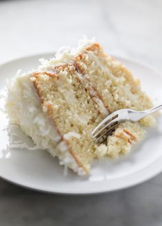 Moist, fluffy, and soft, this four layer Coconut Cake recipe has the perfect amount of sweetness that is filled and topped with coconut cream cheese frosting an Best Dessert Recipes, Fun Desserts, Sweet Recipes, Delicious Desserts, Cheesecake Recipes, Snack Recipes, Almond Muffins, Coconut Recipes, Coconut Cakes
