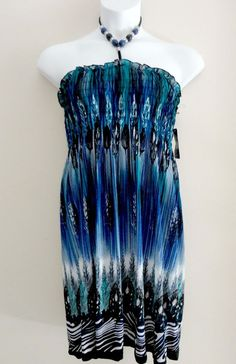 e8a63ec64c1 Womens Plus size Feather Dress with smocked bodice and beaded halter neck  tie. Silky Smooth material with extra stretch. Great as a summer dress or  beach ...