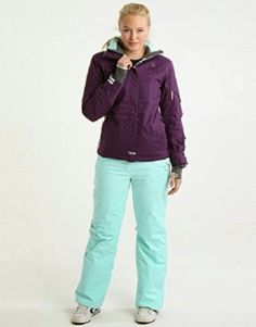 Charlotte in a plum ski jacket;  with mint green ski pants.