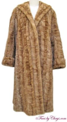 SOLD! Vintage Pastel Mink Sections Coat #PM693; Excellent Condition; Size range: 8 - 14 Misses or Petite. This is an adorable vintage genuine natural pastel mink sections coat. It features a large shawl collar, large belled sleeves with turn-back cuffs, and the very stylish interior shoulder straps (so it may be draped dramatically over your shoulders as they did back in the day). This pastel mink fur coat looks as if it has never been worn and it has no monogram! C'est magnifique!
