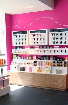 Mademoiselle Bio, distributors of organic cosmetics, by Agence Halley des Fontaines, Retail design, shelfs on pink wall