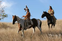 Two Native American men on horseback scouting for enemies or hunting for food in the prairie of South Dakota. Nancy Greifenhagen Photography