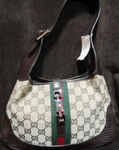 Gucci Designer Handbag in traditional canvas logo print featuring green & red stripe design and short shoulder strap. $238.50