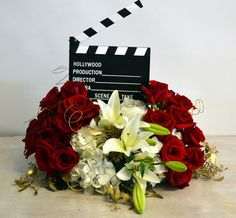 Hooray for Hollywood! The perfect centerpiece for a movie themed event. #Plantationflorist.com