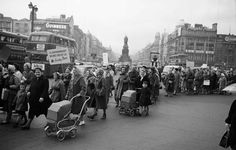 Housewives march in protest at the introduction of Turnover Tax, a new sales tax. The garda wearing white gloves in a raised booth to the centre right of the picture directed traffic on O'Connell Bridge. Dublin Street, Dublin City, Old Irish, Irish Celtic, Old Pictures, Old Photos, Michael Church, Images Of Ireland, Elderly Activities