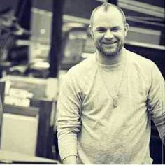 Smiling Ivan Moody. He almost looks like Chris Hemsworth. Give him some long flowing blonde hair and you have Thor. ;-)