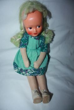 VINTAGE POLAND GERMANY DOLL CLOTH SAWDUST BODY PLASTIC FACE GREEN MOHAIR JOINTED - This one has green hair and that impossibly high forehead like mine had