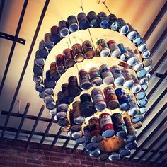 Beer can chandelier. kinda funny for the basement. We're gonna need to drink up! Can I get some help?