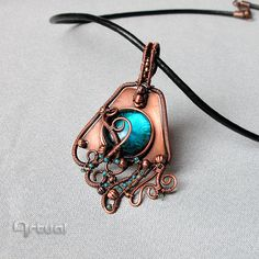 Copper wire pendant with blue glass cabochon on copper by Artual