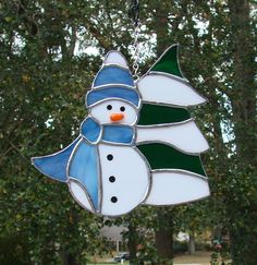 This whimsical snowman will brighten your home on those dreary winter days. The blue glass in his scarf and hat are made of a textured glass that gives it a woven look. The carrot nose is a glued on piece of glass and the eyes and coal buttons are painted on. This snowman is constructed in the Tiffany style of copper foil stained glass. Dimensions: 5 3/4 by 6 1/4 ********************************************** Frequently Asked Questions How do you make your stained glass pieces...