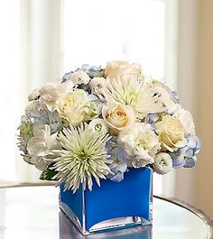 Hanukkah flowers in blue and white are the perfect decoration for all eight nights!