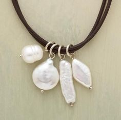 Love the combo of classic pearl and rough and tumble leather. - buy mens jewelry online, mens unique jewelry, mens chains jewelry