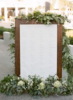 Seating chart created by Tampa Bride Jessica Bexley.   She created this by staining a board, ordering a calligraphy app, printing out the chart at Staples and velcroing it onto the board