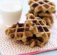 Baking cookie dough in a waffle iron takes about a minute and a half, a real time-saver when you've got to have warm cookies right away. These cookies, excerpted from the book Dessert Express, look like mini waffles, but they bake up just like oatmeal-chocolate chip cookies, with browned, toasty oats on the outside and gooey, melty chips. Once cooled, they look cute garnishing bowls of ice cream.