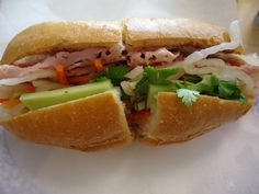 Bahn Mi at Ba-Le in Honolulu, this steamed pork or ham with pate, headcheese, pickled vegetables and the best darn bread for a vehicle- so good!