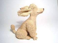 Poodle sculpture by EllensCreatures on Etsy, $75.00 My toy poodle Rufus likes to sit and face the wind just like this.