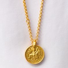 This richly textured gold coin pendant necklace by Julie Vos features a carved knight on horseback with a gentle floral motif behind. A unique statement piece. Horseshoe Necklace, Coin Pendant Necklace, Gold Pendant, Coin Jewelry, Jewelery, Buy Gold And Silver, Lucky Horseshoe, Gold Coins, Jewelry Collection