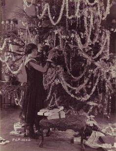 Gloria Swanson decorates her enormous Christmas tree!    I wonder if this shot…