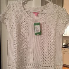 Lilly Pulitzer Wynda Sweater. New with tags Lilly Pulitzer Wynda Sweater. NWT. Resort White. Size Small.   Short sleeve. Crochet look Lilly Pulitzer Sweaters Crew & Scoop Necks