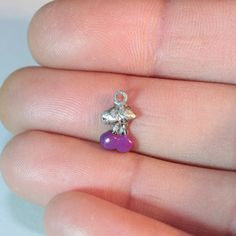 A cherry charm which is purple https://www.etsy.com/ie/listing/515927139/cherry-charm-jewelry-free-shipping