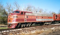 The E8 was a 2,250-horsepower (1,678 kW), A1A-A1A passenger-train locomotive built by General Motors' Electro-Motive Division (EMD) of La Grange, Illinois. 450 cab versions, or E8As, were built from August 1949 to January 1954, 447 for the U.S. and 3 for Canada. 46 E8Bs were built from December 1949 to January 1954, all for the U.S. The 2,250 hp came from two 12 cylinder model 567B engines, each driving a generator to power the two traction motors on one truck. The E8 was the ninth model in…