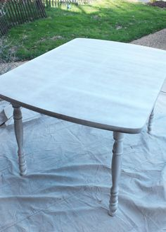 How to paint a laminate kitchen table from Confessions of a Serial Do-it-Yourselfer I like Rustoleum's white spray primer.