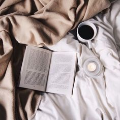 Image via We Heart It http://weheartit.com/entry/215965110/via/39060435 #bed #books #clean #coffee #tan