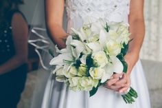 All-White Bridal Bouquet With Lilies And Roses