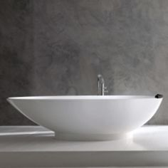 The egg-shaped Napoli bath is both elegant and comfortable. Victoria + Albert create beautiful freestanding baths in QUARRYCAST, a unique material.