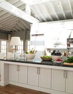 Ina Garten's kitchen design. Counters Caesar stone Raven and Kraftmaid's Brookfield maple cabinets in BM Dove White.