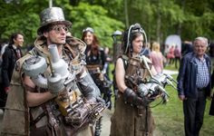 Revellers attend the Victorian Picnic during the Wave and Goth festival in Leipzig, Germany, May 22, 2015. The annual festival, known in Germany as Wave-Gotik Treffen (WGT), features over 100 bands and artists in venues all over the city playing Gothic rock and other styles of the dark wave music subculture. One of the biggest of its kind, the event attracts a regular audience of up to 20,000, the organisers said. (Photo by Hannibal Hanschke/Reuters)