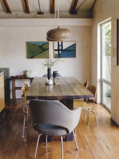 love the natural wood floors - pendant lamps, deco chairs mixed with the farmhouse table. great mix. via - remain simple.