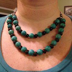 Jewelry Designs by Tiffanie  Wood beads on leather