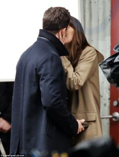 Started with a kiss! Dakota Johnson and Jamie Dornan were seen puckering up in character o...