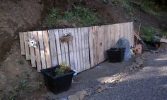 Retaining wall built out of tires and pallets for under 10.00!!