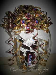 Large beer mug with fun size snickers overflowing with mini snickers