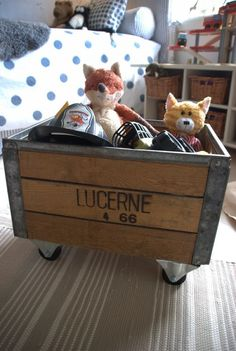 A wooden crate is an innovative and charming way to corral toys