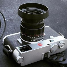 #leicam10 with the #ventilated #lens #shade by #thorstenovergaard on the 50mm #summilux #limited #black #chrome. Genius lens shade that sits tight on the lens AND takes 43mm@filters on the front! Available on overgaard.dk Strap by @tieherupstraps (view on Instagram http://ift.tt/2lUo3nJ)